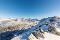Bright winter scenery in the mountains, with frost and rocks covered with fresh snow. On a cold freezing day Stock Images