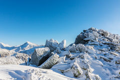 Bright winter scenery in the mountains, with frost and rocks covered with fresh snow. On a cold freezing day Stock Image