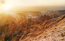 The bright winter sunset. The amazing winter sunset over the Cappadocian Red Valley, full of peaked cone colored rocks, Turkey Royalty Free Stock Image
