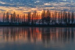 Bright winter sunset, river landscape stock images