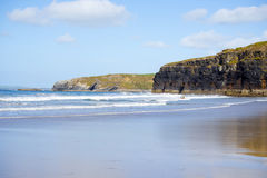Bright winter view of kayaker at ballybunion sandy beach Stock Photos
