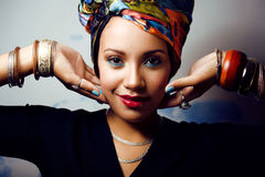 Bright woman with creative make up, shawl on head Stock Image