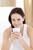 Bright woman drinking a coffee Stock Photo