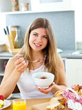 Bright woman eating cereals with strawberries Stock Photography