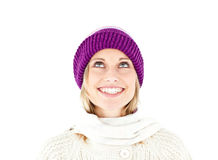 Bright woman with hat and pullover looking upwards Royalty Free Stock Image