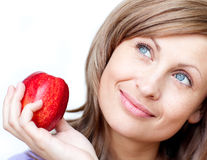 Bright woman holding an apple Royalty Free Stock Images