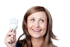 Bright woman holding a light bulb Stock Photo