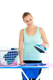 Bright woman ironing her clothes Stock Photos