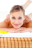 Bright woman lying on a massage table Royalty Free Stock Images