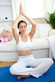 Bright woman practicing yoga in her living-room Royalty Free Stock Photos