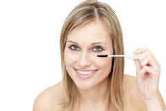 Bright woman putting mascara Royalty Free Stock Photography