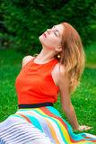 Bright woman relaxing on the lawn Stock Photography