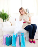 Bright woman with shopping bags at home Stock Photo