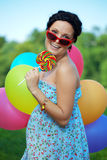 Bright woman in sunglasses Royalty Free Stock Image