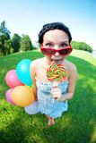 Bright woman in sunglasses Stock Images
