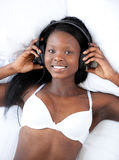 Bright woman in underwear listening music Stock Photo