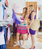 Bright women choosing clothes together Royalty Free Stock Photos