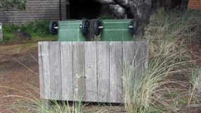 Garbage Recycle Can Shed Made of Wood. Protects Cans in Wind stock image