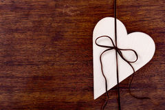 Bright wooden heart tied with a strap Stock Image