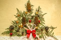 Bright plywood with a Christmas tree,of twigs thuja  with fir cones and chocolate on lace ribbon Royalty Free Stock Photography