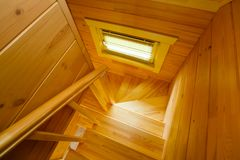 Bright wooden staircase, small window top view stock images