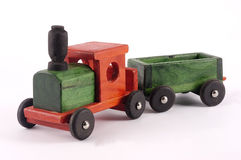 A bright wooden toy train. Isolated on a white back ground Royalty Free Stock Images