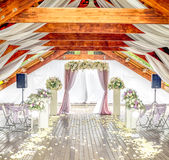 Bright wooden wedding ceremonial hall. With floral arch close up stock photos