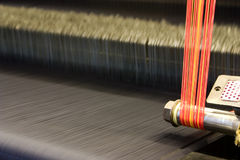 Bright Wool Weave Loom. Weave cloth with colorful threads, abstract view Stock Image