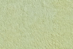 Bright woolen carpet texture. Bright light yellow woolen carpet texture Royalty Free Stock Photography