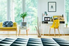 Free Bright Workspace With Yellow Chair Stock Photos - 104070743