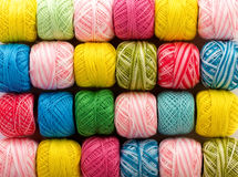 Bright yarn. Bright multi-colored texture of cotton yarn skeins Royalty Free Stock Photos