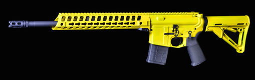Bright yellow AR15 with 20rd mag Royalty Free Stock Photos