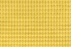 Bright yellow background from soft fleecy fabric close up. Texture of textiles macro Royalty Free Stock Images