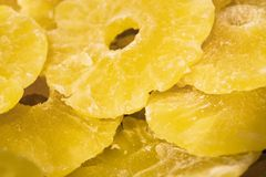 Bright yellow background or texture. Tropical dried fruit the pineapple cut on rings. Summer and exotic. Vitamins and useful fruit stock images
