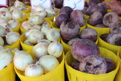 Bright yellow baskets with onions and turnips Royalty Free Stock Image