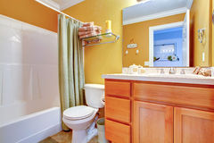 Bright yellow bathroom interior Stock Images