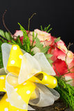 Bright yellow bow on wedding bouquet Royalty Free Stock Image
