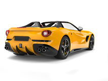 Bright yellow cabrio sports car - back view Stock Images