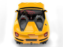 Bright yellow cabrio sports car - top down view Royalty Free Stock Images