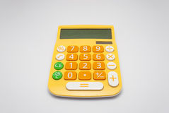 Bright Yellow Calculator with Solar Cell, Isolated.  royalty free stock photos