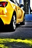 Bright Yellow Car. Rear view of a bright yellow sports car Royalty Free Stock Photography