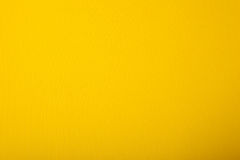 Bright yellow cardboard. Bright yellowdesigner paper having the texture Stock Photo
