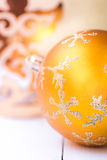 Bright yellow Christmas tree bauble with sparkling silver snow flake ornament, golden angel, flare, magic, greeting card Stock Images