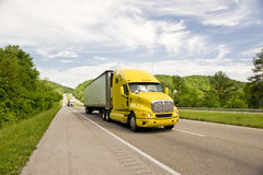 Bright Yellow Diesel Truck On Highway Royalty Free Stock Photos