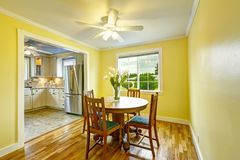 Bright yellow dining room Royalty Free Stock Photo