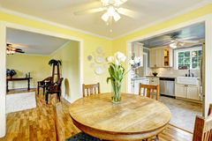 Bright yellow dining room Stock Images