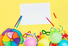 Bright yellow Festive background with empty blank and party tools and decoration - baloons, funny carnival masks, festive tinsel a royalty free stock photos