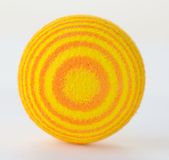 Bright Yellow Foam Ball Isolated Against A White Background. Royalty Free Stock Photo