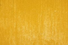 Bright yellow golden painted wood panel board with paintbrush texture Stock Photos