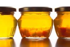 Bright yellow jam - dandelion flower honey in glass jars on whit Royalty Free Stock Images